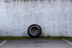 5 (James_D_Images) Tags: parking space number 5 concrete wall sign old tire moss lines circle