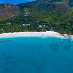Deep blue water and an amazing beach in Grand'Anse Praslin, Seychelles - aerial photography thumbnail