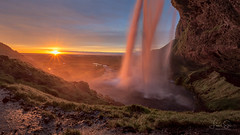 Sunset at Seljalandsfoss (lsten) Tags: majestical rock natureview sharp amazing nature seljalandsfoss alcove bracketing theunforgettablepictures haze hdr summer tripod wideangle amateurphotography iconic landscapephotography golden trail sky viewingpoint waterfall view travelphotography goldenhour amphitheater sunset sunrays cliffs sun stream iso100 laowa12mmf28zerod canoneos6d magnificent scenery clouds rays iceland ray colorful serenity cave naturephotography landscape bracketed f16 colors green 12mm rocks beautiful stunning