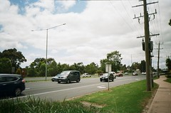 Maroondah Highway (another photo of it) (Matthew Paul Argall) Tags: halinavisionxf kodakultramax400 400speedfilm 400isofilm kodak400 ultramax fixedfocus focusfree 35mmfilm plasticlens cheaplens highway street road traffic car cars