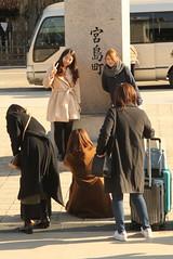 IMG_4865a (jumppoint5) Tags: together street miyajima hiroshima welcome girls smile wefie urban japan