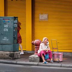 Waiting for the call (Goran Bangkok) Tags: yellow red bangkok thailand chinatown woman phone telephone street streetphotography door