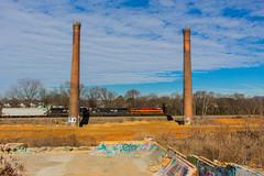 Passing the Mill (Troy A. Snead) Tags: emdsd70mac kansascitysouthern foreignpower freighttrains greenvillesc