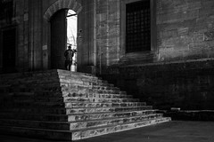 stairs to light / don't forget to close the door (Özgür Gürgey) Tags: 2016 35mm bw d750 dxonfx darkcity eminönü nikon architecture door evening geometry grainy lowlight people stairs street istanbul