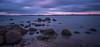 Calm (Nikhil Ramnarine) Tags: newzealand northisland auckland beach pebblebeach rocks shellstone calm calmwaters stormyclouds sunset pinksky longexposure softwater soldiers shoreline