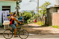 intersection.jpg (BradPerkins) Tags: touristshop bicycle people lookingout cuba person streetphotography watching bike vehicle riding trinidad