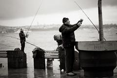 The Cigarette (Erman Peremeci) Tags: fisherman sonya6500 badweather karaköy istanbul scenery line fishing seaside sea people sky sonnartfe55mmf18za fish