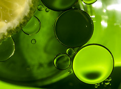 Take 3 (Laurie4593) Tags: abstractmacro lime citrus oil water circles spheres green canonrebelt3i sigma70mmf28exdgmacro