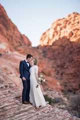Meet me in the desert (aamith) Tags: redrock 85mm groom kiss desert bride wedding