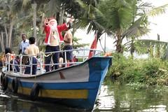 Kerala Backwaters - Santa Claus Arrives by Boat (zorro1945) Tags: santa santaclaus fatherchristmas stnicholas kerala idia asia asie keralabackwaters southindia backwaters river canal longboat christmas celebration