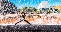 Color-Splash :-) (ThorstenKoch) Tags: street streetphotography schatten stadt strasse shadow summer sun sonne sky splash water waterfall kid jump streetcolor colorful color blue orange yellow green fuji fujifilm tuesday pov photography people photographer picture pattern portugal place expo lissabon lisboa lisbon urban fun spas laughing lachen holliday europe thorstenkoch