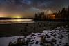 Milky Way Smokehouse (Adam Woodworth) Tags: beach cove downeast lightpollution maine milkyway newengland pylons smokehouse snow starstacking stars winter