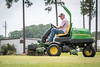 Man using ride lawn mower to cut turf grass, .Tifton, Georgia. (Remsberg Photos) Tags: grass turf sod soil lawn lawnmower outdoors thesouth americansouth turfcapital agriculture mechanical machinery machine mower grasscutter ridingmower tifton georgia usa