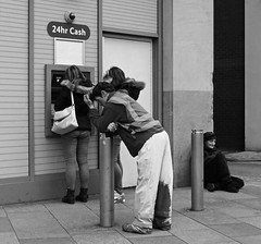 Heaven is a place on earth (Andy WXx2009) Tags: monochrome streetphotography blackandwhite candid cardiff people outdoors shopping man women girls femme urban beggar cashpoint bollard wales workers bags city europe leaning sitting