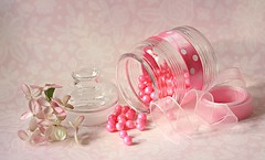 Pink candy beads (Through Serena's Lens) Tags: lifeisarainbow tabletop hydrangeas flower glass jar ribbon beads candy stilllife prettyinpink 7dwf pink