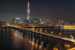 Lotte tower at night (Aaron_Choi) Tags: architecturaldetail architecture asia asian bridge capital city citylights destination district famous freeway gangbyeon gangnam han hanriver highway iconic jamsil jamsilrailwaybridge korea korean landmark lights lotte lottetower night nightlight nightview nigthscape railway railwaybridge river road seoul skyscraper songpa subway tourism traffic travel urban urbanlandscape view viewpoint