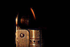 Flame (Steve.T.) Tags: flame macromondays macromonday macro lighter imcotriplex fire ignition heat raynoxdcr250 nikon d7200 metallic imcotriplexjuniorlighter imco retro antique old vintage personalitem lowlight lowkey