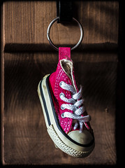 Converse , a key ring. . . (CWhatPhotos) Tags: cwhatphotos converse all star stars foowear boot key ring novelty chucks red closeup macro photographs photograph pics pictures pic picture image images foto fotos photography that have which with contain mk digital camera lens micro four thirds olympus allstars allstar