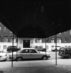 buckingham-awning (kaumpphoto) Tags: dark mamiya c220 120 tlr awning canvas street brick window door glass lamp urban city sidewalk concrete tire wheel handel mercedes minneapolis auto automobile suv