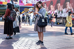 Just The Right Angle (burnt dirt) Tags: asian japan tokyo shibuya station streetphotography documentary candid portrait fujifilm xt1 laugh smile cute sexy latina young girl woman japanese korean thai dress skirt shorts jeans jacket leather pants boots heels stilettos bra stockings tights yogapants leggings couple lovers friends longhair shorthair ponytail cellphone glasses sunglasses blonde brunette redhead tattoo model train bus busstation metro city town downtown sidewalk pretty beautiful selfie fashion pregnant sweater people person costume cosplay brown gray stripes