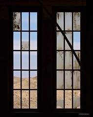 IMGP3970 Window with view (Claudio e Lucia Images around the world) Tags: glass door doorglass colors colored coloured pomona kolmanskop kolmanskuppe pentax pentaxk30 pentax55300 finestra sperrgebiet diamond diamondtown abandonedtown ghost ghosttown