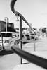 Denton, TX (BurlapZack) Tags: canoneosa2e canonef50mmf14usm kodaktmax400 dentontx film 35mmfilm analog bw mono monochrome rail railing downtown thesquare pacifier hang bokeh dof walkabout sidewalk urban city lines geometry handrail keyring keychain contrast photowalk
