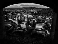 A view of Salzburg in b & w (SM Tham) Tags: europe austria salzburg hohensalzburg fortress castle opening view cityscape landscape dom cathedral buildings salzach river bridges mountains sky blackandwhite monochrome coins