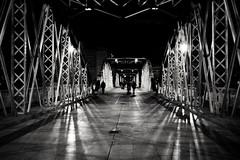Figures on the Iron Bridge. (Fencejo) Tags: canon600dt3ikissx5 canonefs24mmf28stm blackwhitebwstreetcityblackandwitestreetphotographymonochrome zaragoza bridge iron