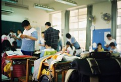 Class Time [2] (issathelakwatsera) Tags: people student table school study room classroom class taiwan travel 35mm analog analogue film konica kodak gold200