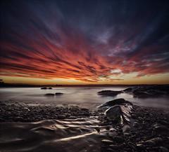 Inferno (Grant Morris) Tags: kirkcaldy ravenscraigbeach grantmorris grantmorrisphotography canon redsky redclouds longexposure rocks wetrocks beach seaside seascape scotland