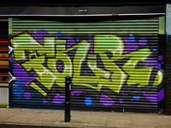 Feeling Shuttered (Steve Taylor (Photography)) Tags: shutter graffiti mural streetart yellow black green mauve purple bollard uk gb england greatbritain unitedkingdom london thc brs crew