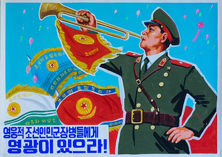 North Korean propaganda poster depicting a soldier blowing in a horn, Pyongan Province, Pyongyang, North Korea