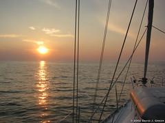Sunset on the Way to Venice (David J. Greer) Tags: sail sailing cruise cruising sailboat boat yacht croatia adriatic family adventure travel mediterranean sunset foredeck calm sea seas horizon dinghy shrouds