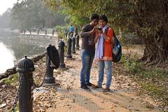 An interesting frame (sanat_das) Tags: kolkata rabindrasarobar lakesidepath couple viewing aninterestingframe streetphotography 50mm d800
