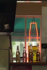 behind the scenes (jim_ATL) Tags: window red neon sign store bar beer bottle keywest florida