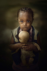 Ethiopia Girl and Doll (mckenziemedia) Tags: ethiopia ethiopian girl doll orphan lowkey portrait ebenezergracechildrenshome love family