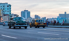 Green old timer on the Malecon at dusk (wellsie82) Tags: americas caribbean centrohabana centrohavana cuba habana habanavieja havana havanavieja lahabana latinamerica malecon maleconavenue straitsofflorida car city classiccar classicalcar copyspace dusk highway holiday landscapeformat motorcar nostalgia nostalgic ocean oldcar road sea street streetlife streetphotography sunset taxi transport travel traveldestination urban vehicle water