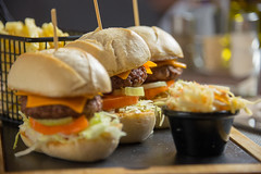 Three little burgers (Syncher) Tags: burger mini bun baguette restaurant beef chips fries coleslaw dof dish platter cutting board cheese cheeseburger d600 nikon zoom
