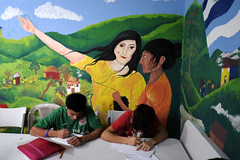 Guatemala. Deputy High Commissioner on mission to Central America (ACNUR Guatemala) Tags: boy femalelikeness indoors malehumangender mural sitting table twopeople undeputyhighcommissionerforrefugees visit writing guatemalacity guatemala gua