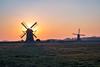 Doeshofmolen and Munnikkenmolen, Leiderdorp (Holland) (mesocyclone70) Tags: sunset windmill landscape holland netherlands mill sky grass field scenery scenic dutch winter orange color cold leiden leiderdorp sun