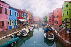 Misty Morning On Burano, Venetian Lagoon, Italy (fesign) Tags: architecture boat brightcolours building buildingexterior builtstructure burano canal city colourimage day distant door europe facade feature floatingonwater fog house italianculture italy lagoon mist moored morning multicoloured nauticalvessel nopeople outdoors photography reflection residentialbuilding street tranquility travel traveldestinations unescoworldheritagesite venetianlagoon veneto veniceitaly wall washingline water window