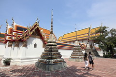 Wat Pho, Bangkok, Thailand. (Colin Kavanagh) Tags: thailand lovethailand visitthailand tourismauthoityofthailand tat chedis buddhism buddhisttemple watpho bangkok amazingthailand beautifulbangkok sunnyday people couple lightandshadow worship daytime ngc lonelyplanet travel travelphoto travelphotography culture religion