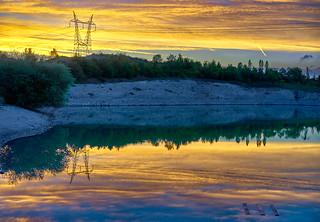 Sunset landscape reflection.