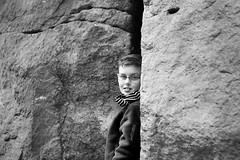 Between a rock and a hard place (Wilamoyo) Tags: ilkleymoor boy little glasses specs rock wall stone hard big hole gap portrait child kid junior male