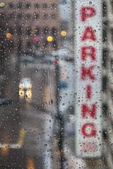lot full (jim_ATL) Tags: raindrops window rain red sign parking garage street car headlight dof atlanta explored