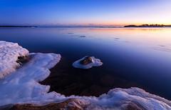 The Sweet Solitude (tinamar789) Tags: ice icy winter cold frozen sea seashore seascape sunset snow rocks horizon blue bluehour light lauttasaari helsinki finland