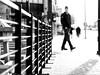 Glaring (George Stastny. Photographer.) Tags: street streetphotography streets edmonton alberta canada getolympus olympus omd em1 45mm mzuiko monochrome blackandwhite bnw bw