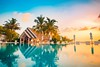 Tropical beach reflection (icemanphotos) Tags: relax sunset loungers palms relfections poolside parasol