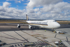 Singapore Airlines Cargo | B747-400 | 9V-SFM (Anthony Kernich Photo) Tags: 9vsfm airplane aircraft airplanepicture airplanephotograph airplanephoto adelaide adelaideairport closeup longlens plane aviation jet olympusem10 olympus olympusomd commercialaviation planespotting planespot aeroplane flight flying airline airliner kadl kpad adl airport cargo heavy freighter boeing 747 boeing747 boeing747400 747400f sq singaporeairlines singaporeairlinescargo cargoplane jumbojet pushback sqc