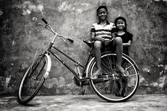 Friends... Street photography in Cambodia  I was walking past when I saw these two friends sitting on their parked bicycle... I thought it made a great picture... Any opinions? (Ib photography uk) Tags: friends people bestfriends bicycle relaxing asia cambodia travel travelling traveling travelphotography streetphotography street streetartist blackandwhite blackandwhitenaturallight blackandwhitenatural blackandwhiteportrait blackandwhitephotography sony sonypictures sonyuk sonyasia sonyrx100 rx100 sonyzeiss sonyimages sonycamera person life lifestyle lifeinpictures world worldphotography earth ibphotographyuk ibphotography buxz777